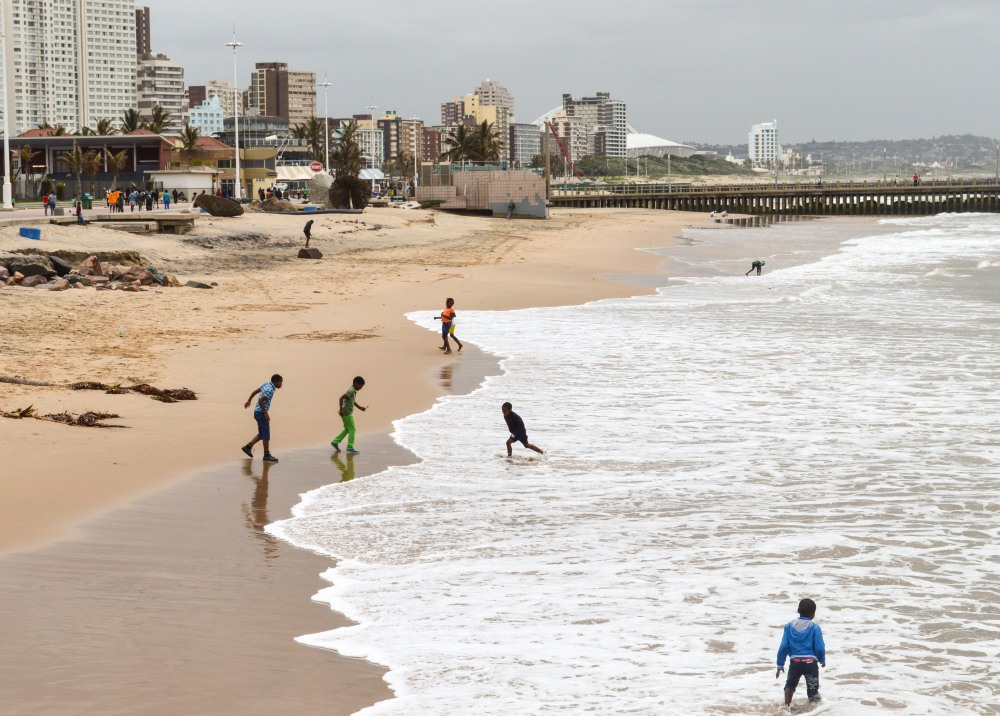 Young Zulu children playing along the Golden Mile beach in Durban 2015